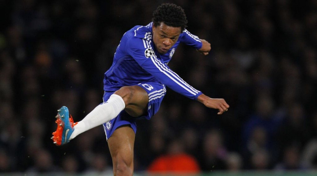 Loic Remy shoots and scores or Chelsea in the Champions League
