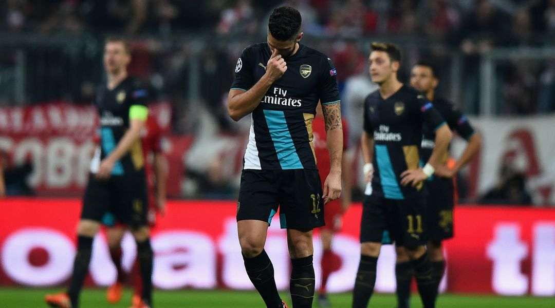Olivier Giroud and his Arsenal teammates react to defeat at Bayern Munich